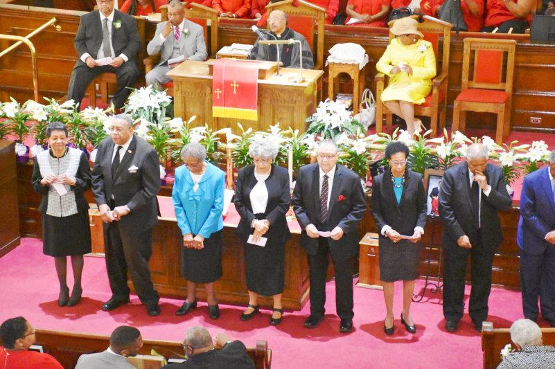 Speakers praying